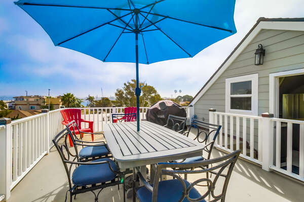 Upper level patio of this San Diego County Vacation Rental, with grill and covered table.