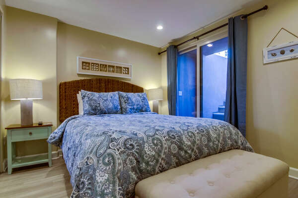 Master Bedroom with large bed and nightstand.