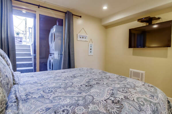 Master Bedroom with large TV and close proximity to the laundry room.