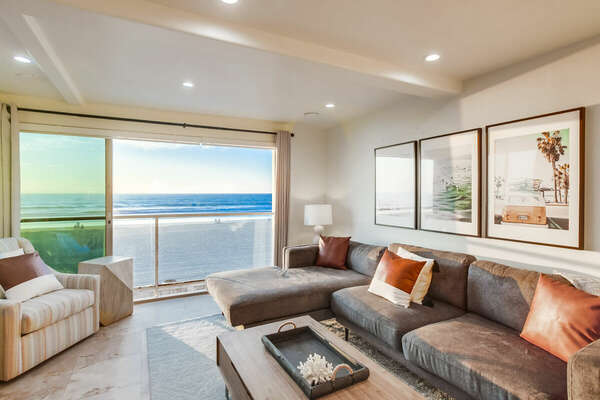 Oceanfront views from living room, leading to balcony