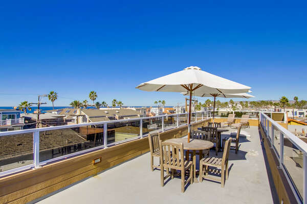 Outdoor Tables, Umbrellas, and Chairs in the Roof Deck.