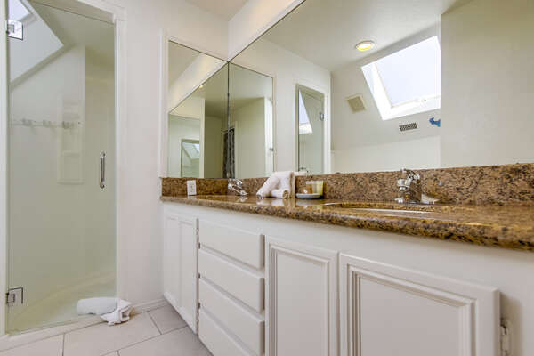 Double Sink Vanity Bathroom with Walk-In Shower.