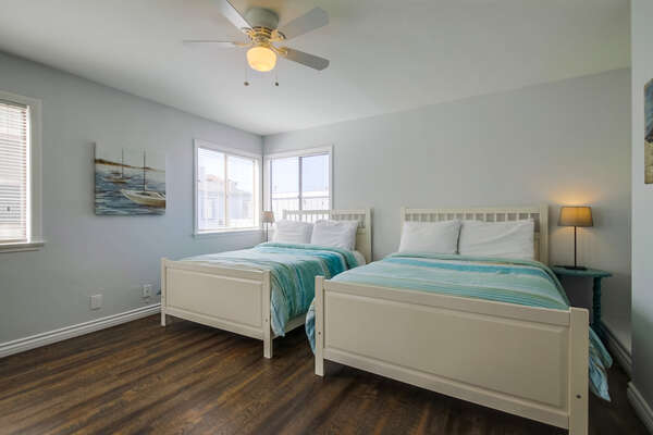 Bedroom 3 with two Full Beds and Ceiling Fan