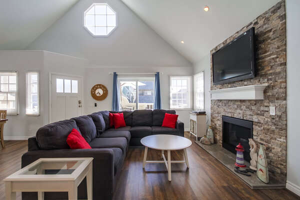 Living Room with Sectional, TV, and Fireplace