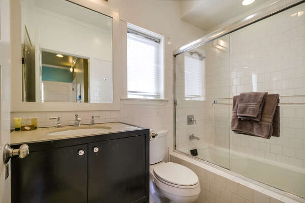 bathroom with hallway access in lower unit