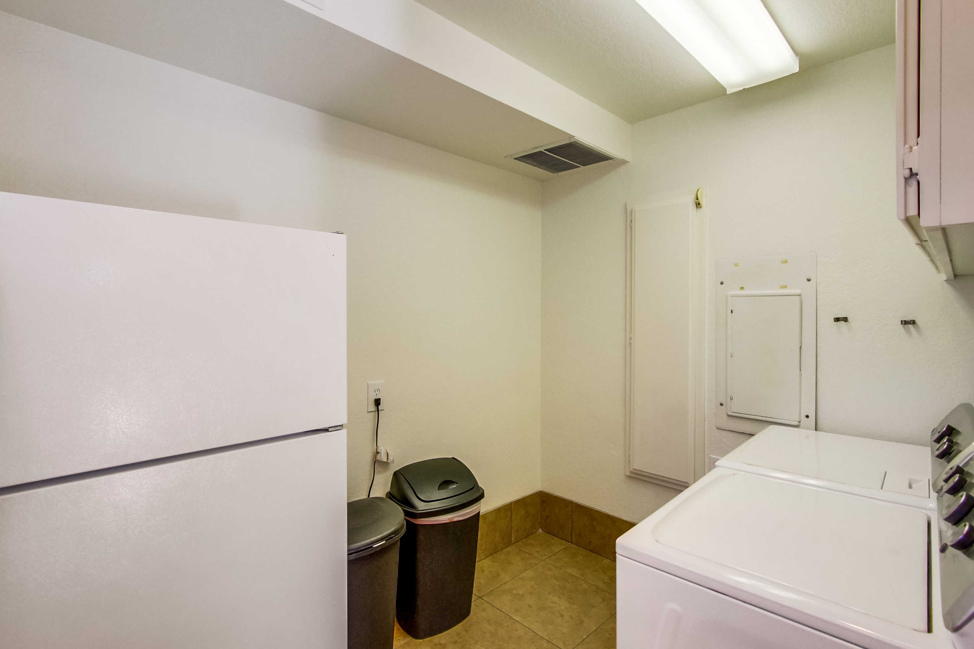Laundry Room with Washer, Dryer, and Fridge.