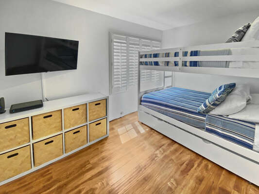 Bedroom with Bunk Bed, TV, and Cubby Console.
