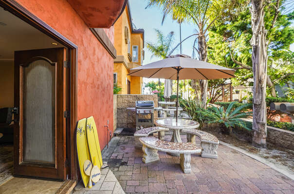 Ground Floor Patio w/ BBQ, Dining, & Lounging