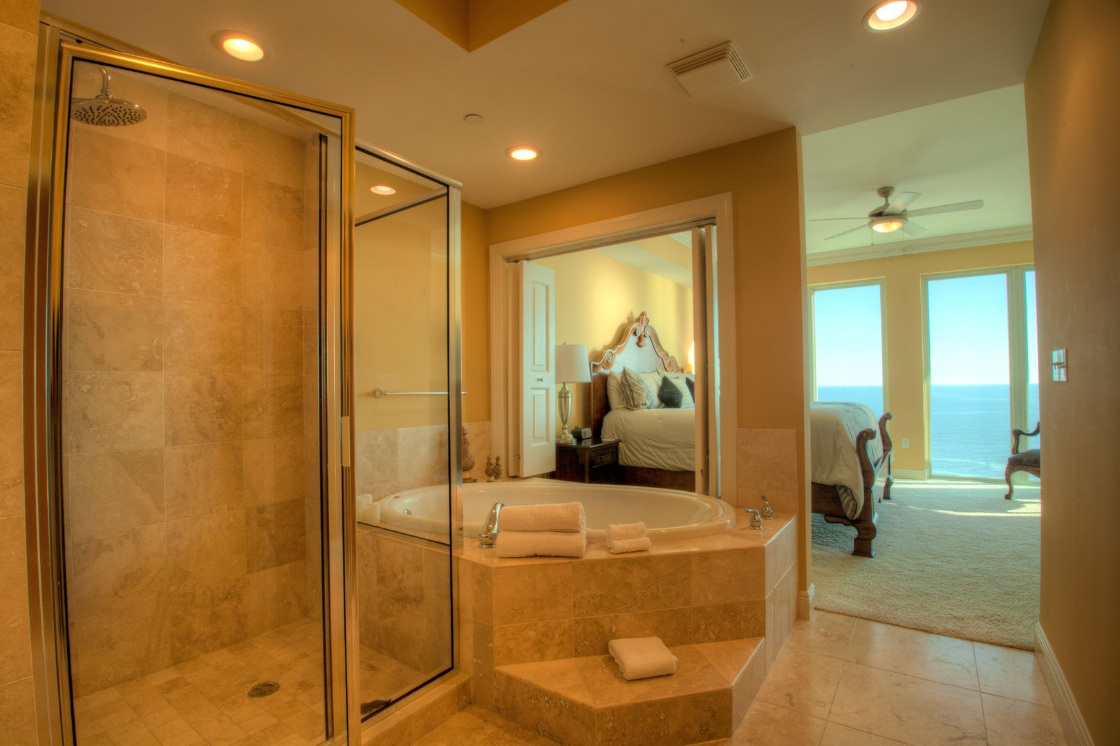 Shower with Glass Door, Hot Tub, Large Bed, and Windows.