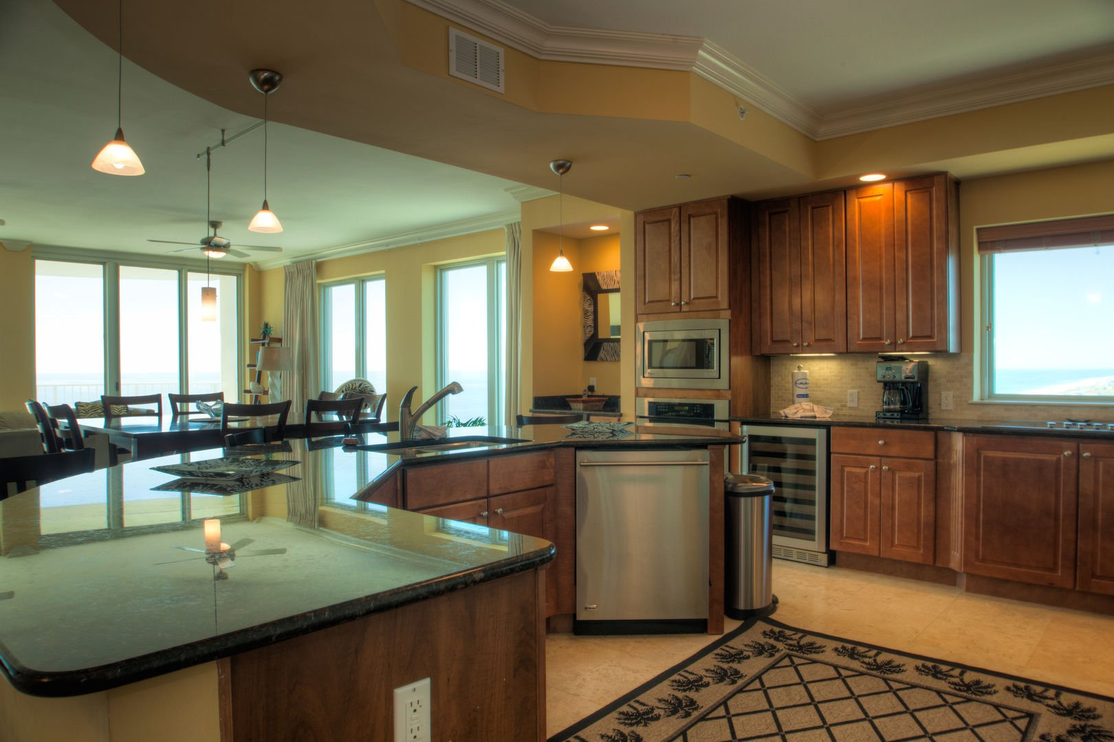 Kitchen with Island, Dishwasher, Wine Cooler, Microwave, and Dining Set.