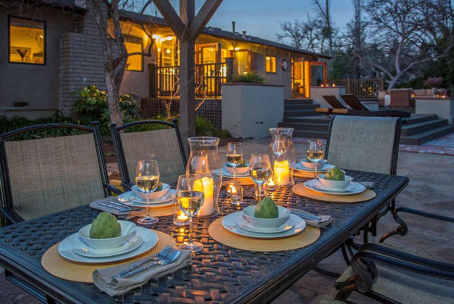Romantic dinner under the arbor in the backyard