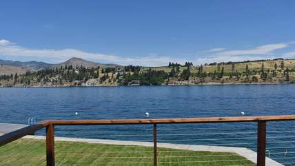 Enjoy beautiful views of Lake Chelan and the sunshine on this outdoor deck.