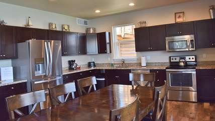 Large open kitchen with granite and stainless appliances - it has great views, too!