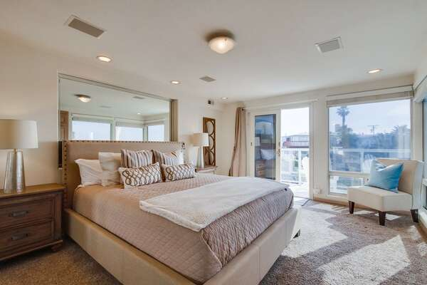 Master Suite with large bed and dual nightstands.