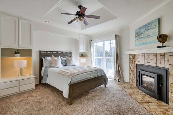 Second Floor Suite with fireplace and large bed.