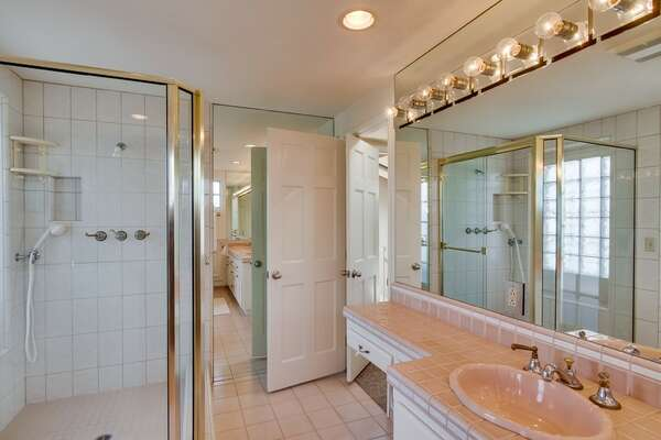 Master Bathroom with walk in shower and vanity sink.