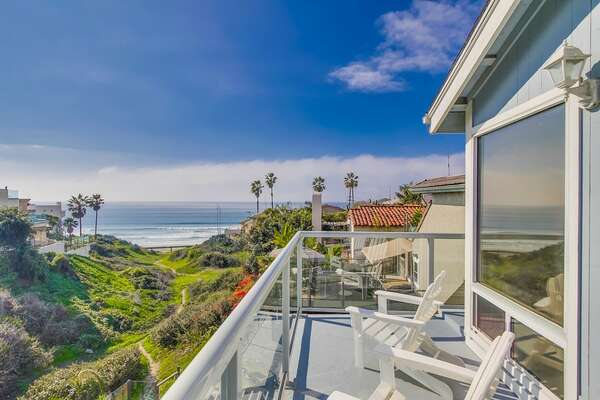 Master Suite of this San Diego vacation home rental with private patio overlooking the ocean.
