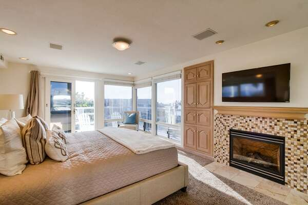 Master Suite with fireplace and wall mounted TV.