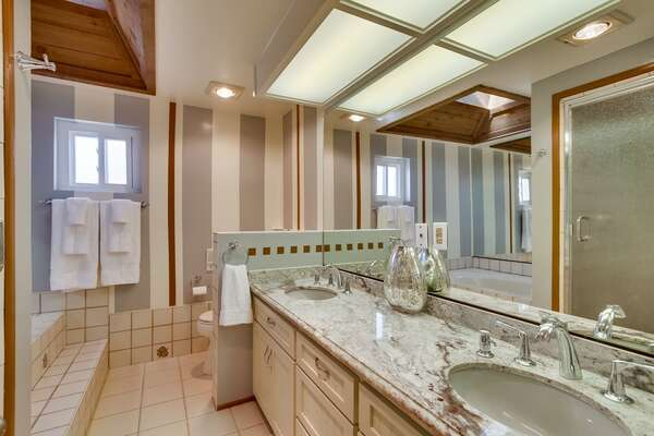 Second Floor-Suite Bathroom with double vanity sink and luxury tub.