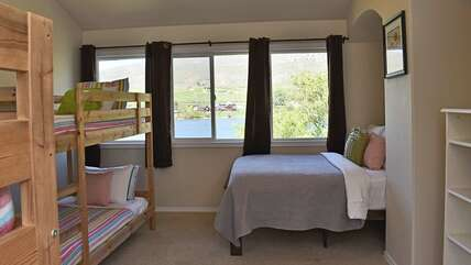 Bunk room in the Main House - 2 twin bunk beds and 1 full bed - with a beautiful view of the river