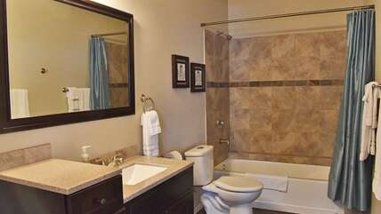 Downstairs full bathroom with tub/shower combination