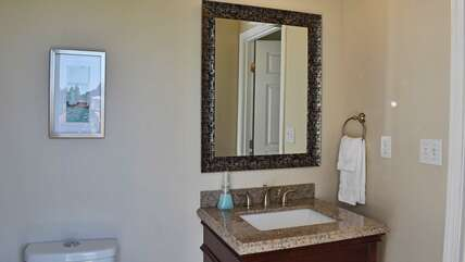 Downstairs half bath - with exterior door - great for a quick bathroom stop while you're playing at the lake!