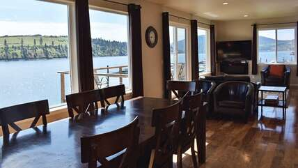 Wall of windows in the living room with beautiful views! Living room leather couches and large flat-screen TV and electric fireplace.