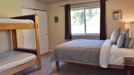 Upstairs room with queen bed and bunkbed