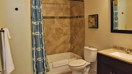 Upstairs guest bathroom with tub/shower