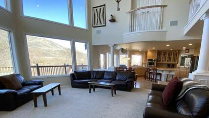 Large open living room with many windows