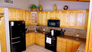 Kitchen equiped with all cooking utensils, microwave, new stove, dishwasher, fridge, blender, toaster, coffee maker.
