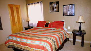 King size bed with updated bedding & decor.