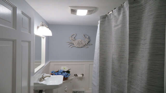 Full bathroom off of the hallway with tub and shower - 13 Carol Lane West Harwich Cape Cod New England Vacation Rentals