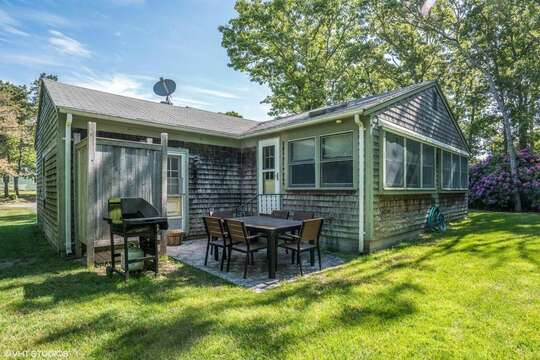 Back of the home with a large yard - 13 Carol Lane West Harwich Cape Cod New England Vacation Rentals