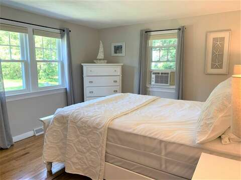 Bedroom #1 with Queen bed and dresser with window a/c unit.13 Carol Lane West Harwich Cape Cod New England Vacation Rentals