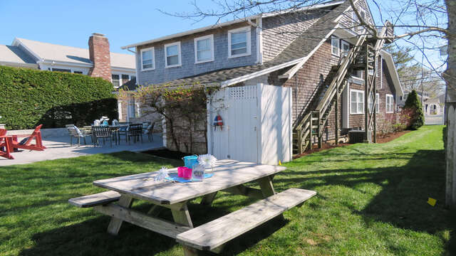 Gas grill and picnic table plus table and chairs on patio- 388 Main Street Chatham Cape Cod New England Vacation Rentals