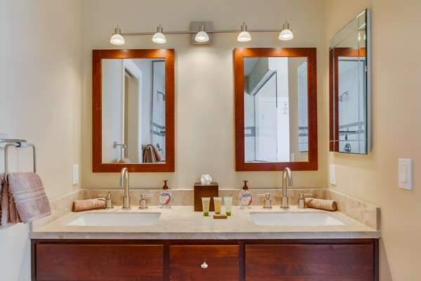 Dual Sink Vanity, Mirrors, and Wall Lamps.