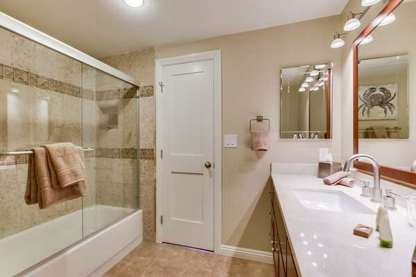 Single Sink Vanity, Mirrors, and Shower-Tub Combo.