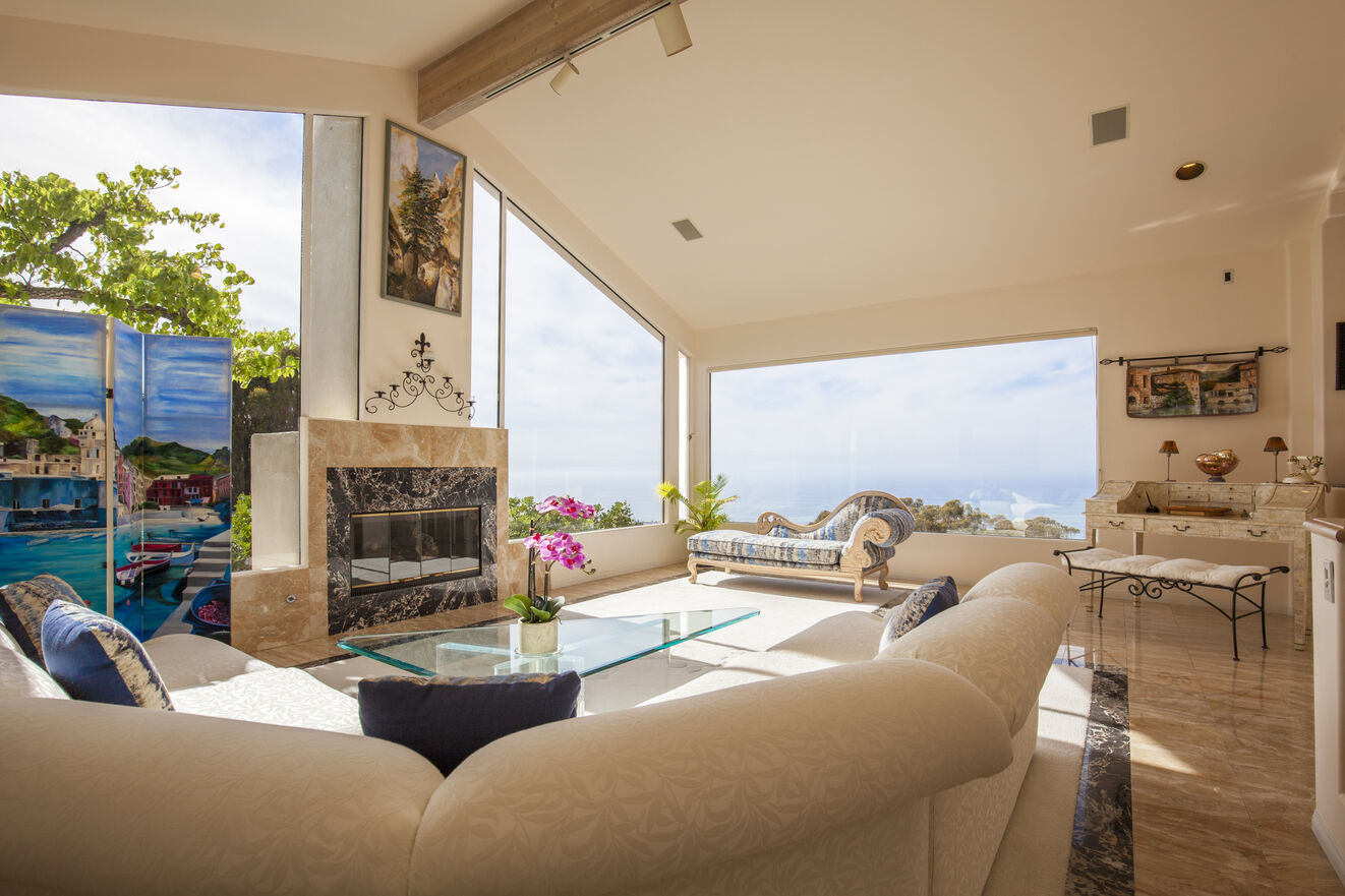 The Living Room features panoramic views of the Pacific Ocean perfect for fireplace and sunset conversations