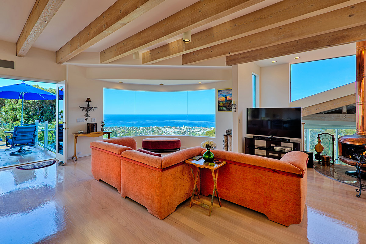 Family room with copper fireplace, HD Smart TV, and amazing ocean views with a private veranda