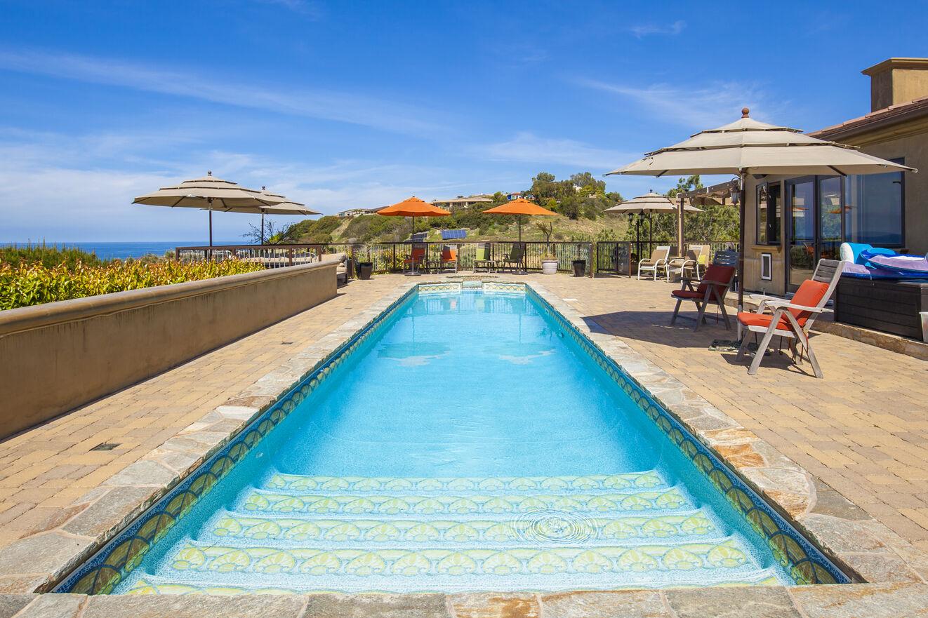 Welcoming saltwater lap pool with ocean views