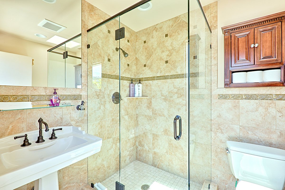 The pool area bathroom includes a large shower