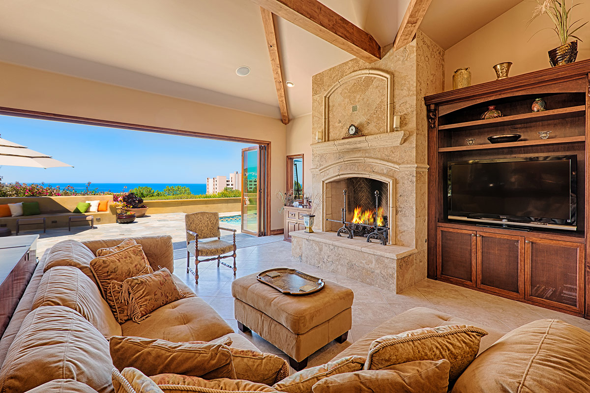 Living room with big TV and multiple media sources, gas fireplace, and unforgettable view