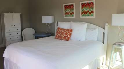 This spacious master bedroom has a king bed and en suite bathroom.