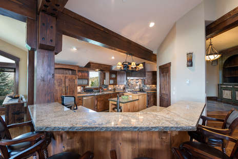Gourmet kitchen with bar seating with 5 bar stools