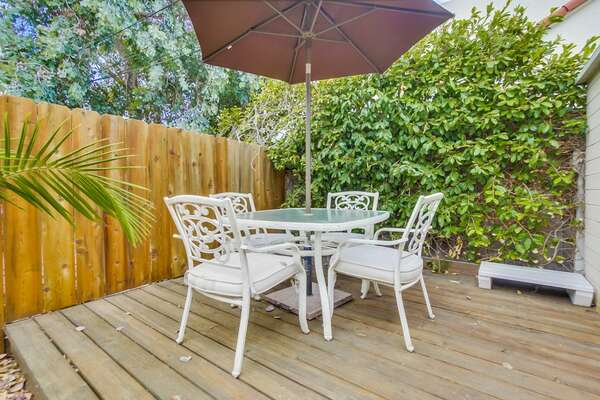 Outdoor Dining Table, 4 chairs, sun umbrella.