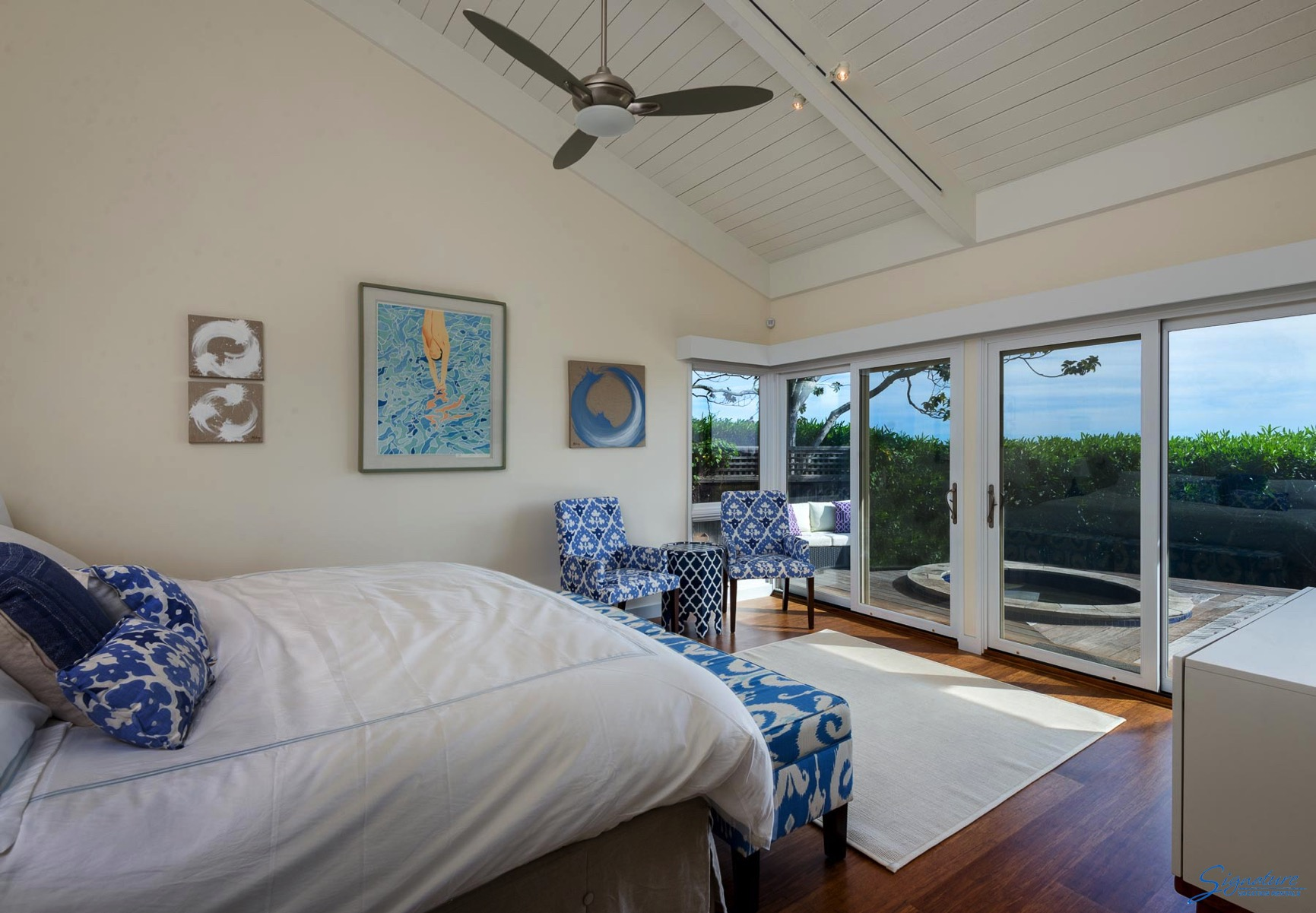 The master bedroom has views of the ocean and a deck with a sunken hot tub.