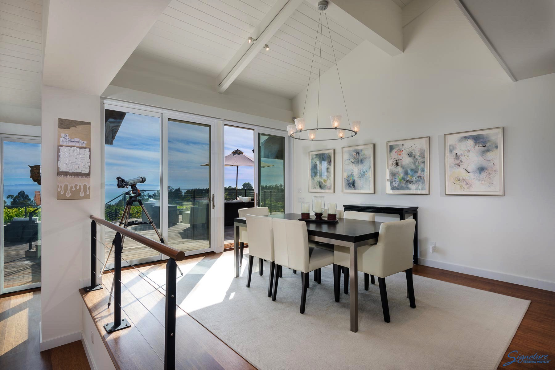 The dining area showcases the wonderful views and has a door to the deck
