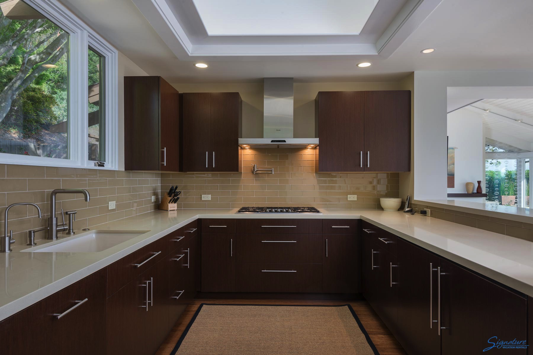Light and bright kitchen with gas stove, stainless steel appliances and a breakfast bar