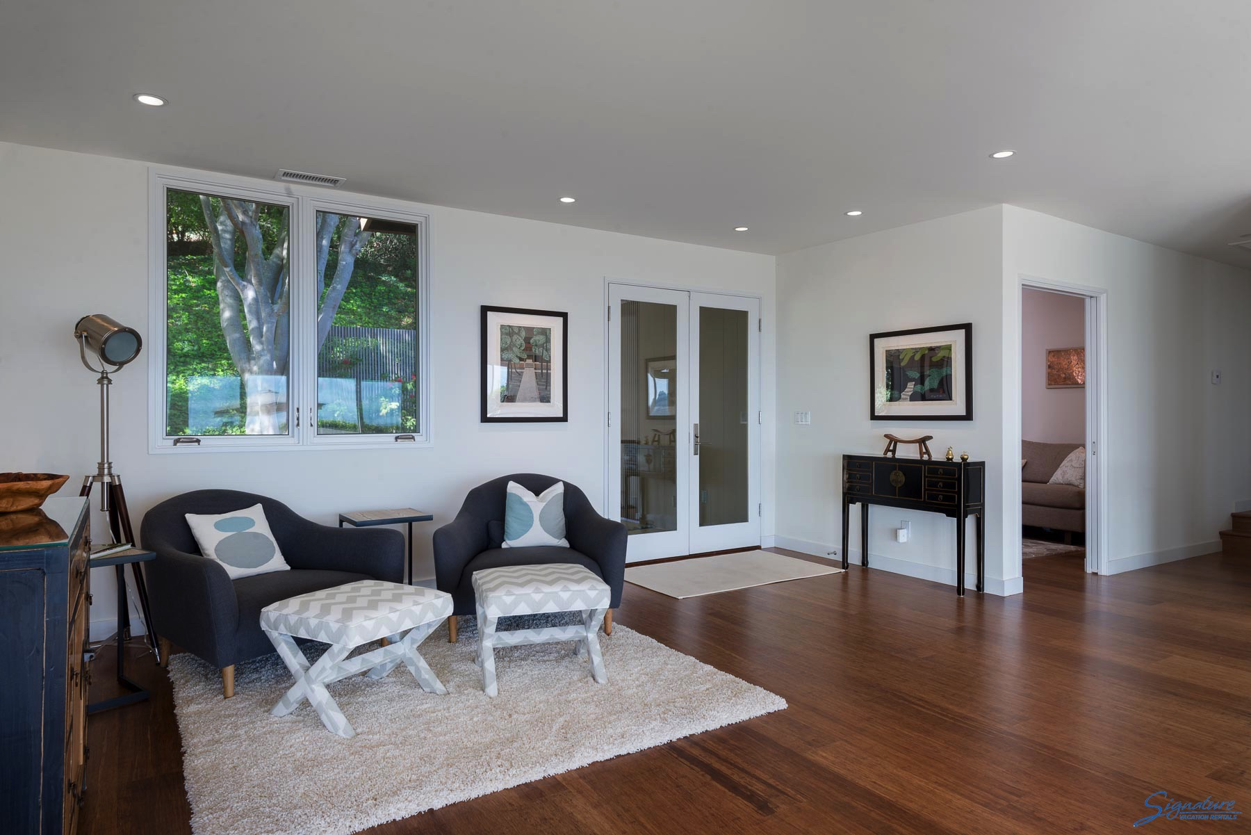 Beautiful wood floors throughout the home. This is a sitting area at the front entrance.